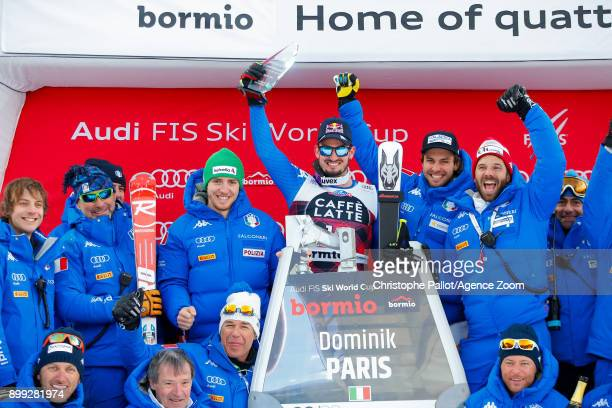 Dominik Paris of Italy takes 1st place and poses with Team Italian during the Audi FIS Alpine Ski World Cup Men's Downhill on December 28 2017 in...