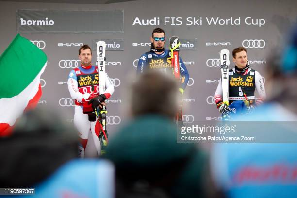 Dominik Paris of Italy takes 1st place, Beat Feuz of Switzerland takes 2nd place, Matthias Mayer of Austria takes 3rd place during the Audi FIS...