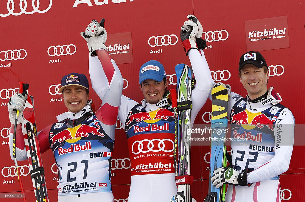 Dominik Paris of Italy takes 1st place, Erik Guay of Canada takes 2nd place, Hannes Reichelt of Austria takes 3rd place during the Audi FIS Alpine Ski World Cup Men's Downhill on January 26, 2013 in Kitzbuehel, Austria.