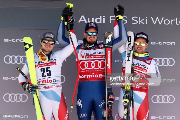 Dominik Paris of Italy takes 1st place Urs Kryenbuehl of Switzerland takes 2nd place Beat Feuz of Switzerland takes 3rd place during the Audi FIS...