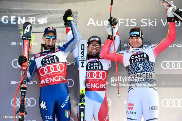 Dominik Paris of Italy takes 2nd place Beat Feuz of Switzerland takes 1st place Thomas Dressen of Germany takes 3rd place during the Audi FIS Alpine...