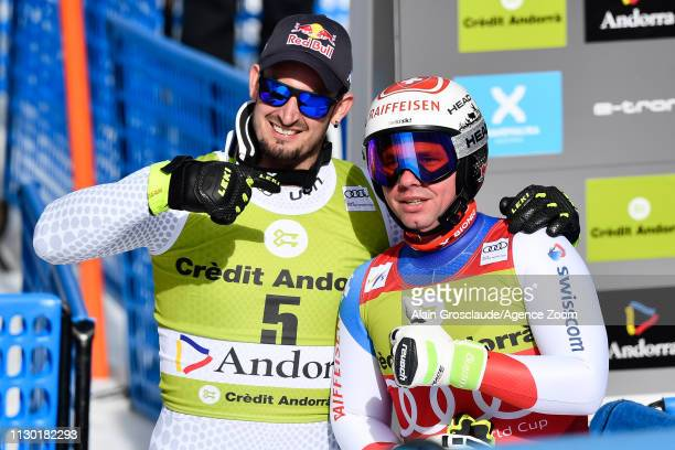 Dominik Paris of Italy takes 2nd place in the overall standings Beat Feuz of Switzerland takes 1st place in the overall standings during the Audi FIS...