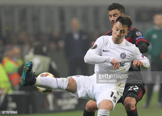 Dominik Prokop of Austria Wien is challenged by Mateo Musacchio of AC Milan during the UEFA Europa League group D match between AC Milan and Austria...