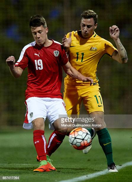 Dominik Prokopp of Austria competes for the ball with Alex Gersbach of Australia during the international friendly match between Austria U21 and...