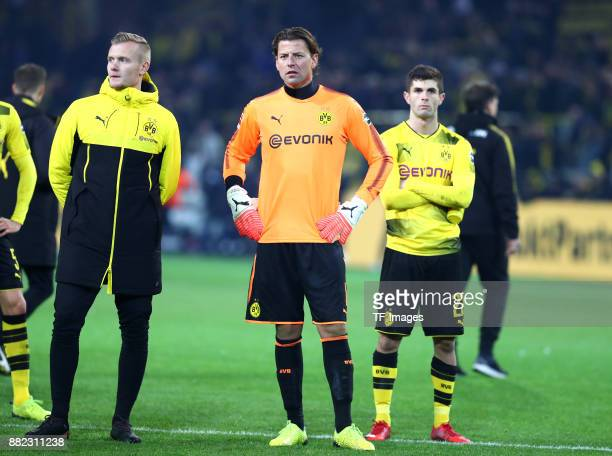 Dominik Reimann of Dortmund Roman Weidenfeller of Dortmund and Christian Pulisic of Dortmund looks dejected during the Bundesliga match between...