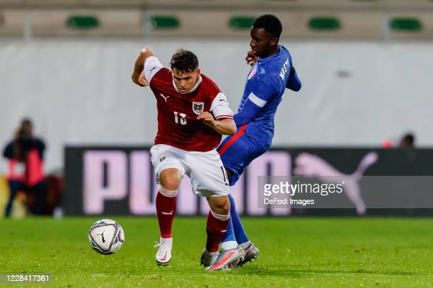 Dominik Reiter of Austria and Eddie Nketiah of England battle for the ball during the UEFA Euro Under 21 Qualifier match between Austria U21 and...