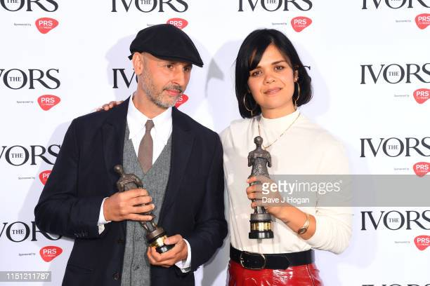 Dominik Scherrer and Natasha Khan winners for Best Television Soundtrack pose in the winners room at The Ivors 2019 at Grosvenor House on May 23,...