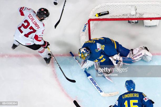 Dominik Schlumpf scores a goal against Goalie Henrik Lundqvist which was annulled during the Ice Hockey World Championship Quarterfinal between...