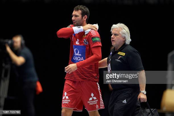 Dominik Schmid of Austria gets injuried during the IHF Men's World Championships Handball match between Austria and Chile in Jyske Bank Boxen on...