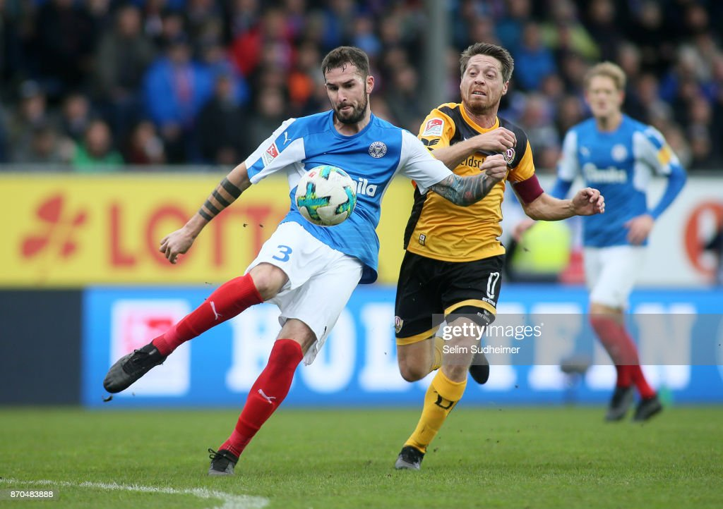 Dominik Schmidt of Holstein Kiel (L) fights for the ball with Andreas Lambertz of Dynamo Dresden during the Second Bundesliga match between Holstein Kiel and SG Dynamo Dresden at Holstein-Stadion on November 5, 2017 in Kiel, Germany.