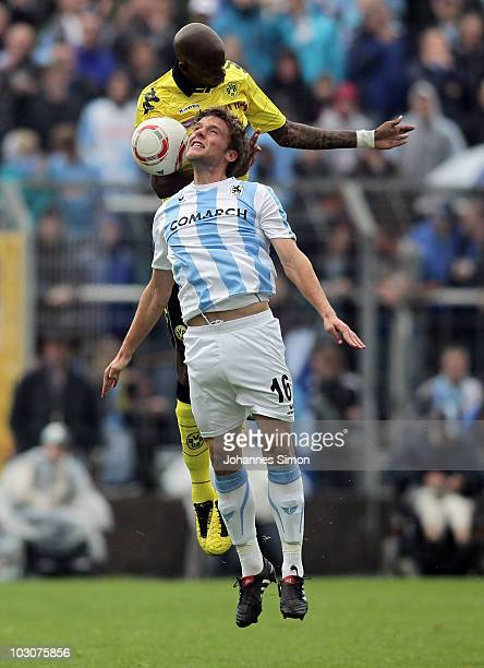 Dominik Stahl of Muenchen and Felipe Santana of Dortmund fight for the ball during the preseason friendly match 1860 Muenchen v Borussia Dortmund at...