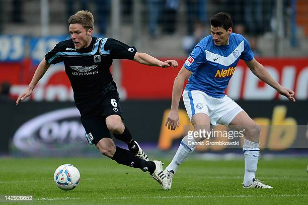 Dominik Stahl of Muenchen is challenged by Giovanni Federico of Bochum during the Second Bundesliga match between VfL Bochum and 1860 Muenchen at...