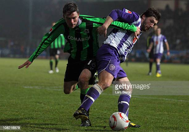 Dominik Stahl of Muenchen is challenged by Sebastian Tyrala of Osnabrueck during the Second Bundesliga match between VfL Osnabrueck and 1860 Muenchen...