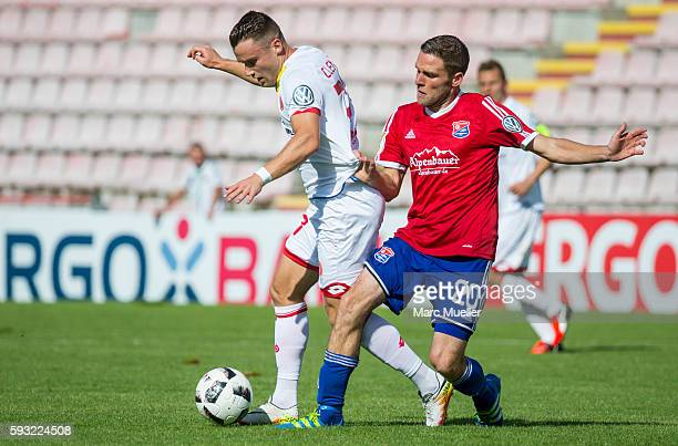 Dominik Stahl of Unterhaching is challenged by Christian Clemens of Mainz 05 during the DFB Cup match between SpVgg Unterhaching and 1 FSV Mainz 05...