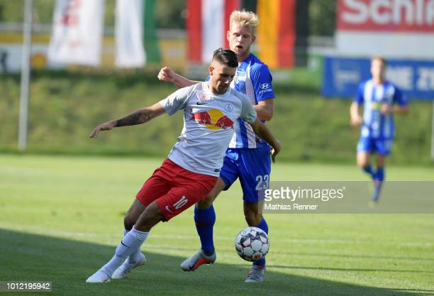 Dominik Szoboszlai of FC Liefering and Arne Maier of Hertha BSC during the game between FC Liefering against Hertha BSC at the Athletic Area...