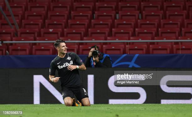 Dominik Szoboszlai of RB Salzburg celebrates after scoring his team's first goal during the UEFA Champions League Group A stage match between...