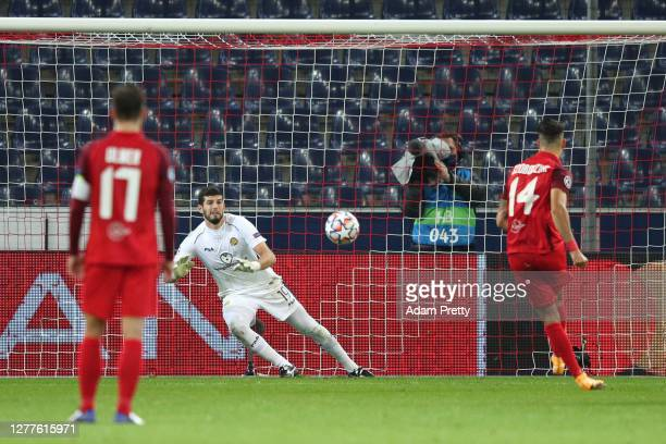Dominik Szoboszlai of RB Salzburg scores his sides second goal during the UEFA Champions League Play-Off second leg match between RB Salzburg and...