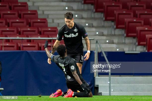 Dominik Szoboszlai of Red Bull Salzburg with Sekou Koita of Red Bull Salzburg celebrates after scoring his team's first goal during the UEFA...