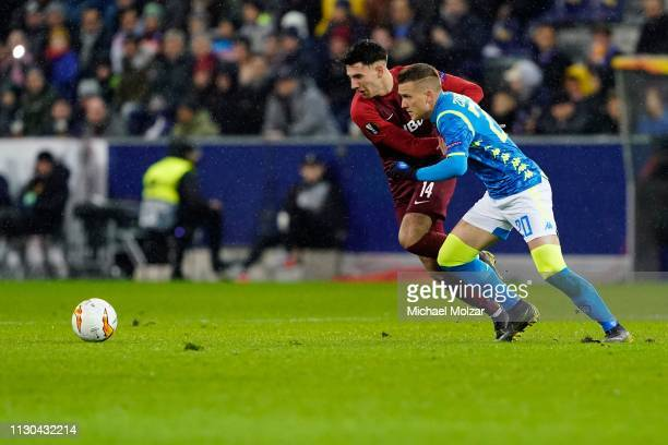 Dominik Szoboszlai of Salzburg and Piotr Zielinski of SSC Napoli fight for the ball during the UEFA Europa League Round of 16 match between FC...