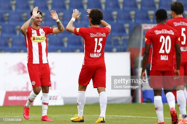 Dominik Szoboszlai of Salzburg celebrates with scorer Andre Ramalho of Salzburg during the tipico Bundesliga match between Red Bull Salzburg and TSV...