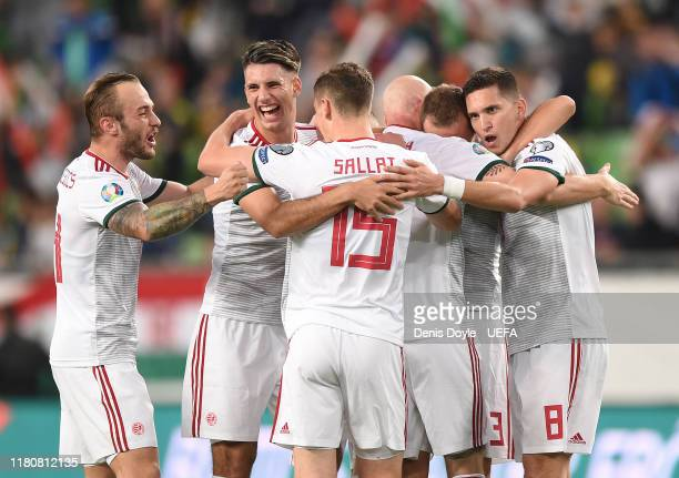 Dominik Szoboszlai, Ronald Sallai and Mate Vida of Hungary celebrate after their team scored their opening goal during the UEFA Euro 2020 qualifier...