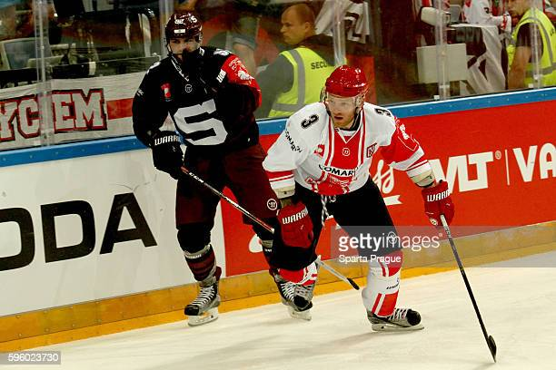 Dominik Uher of HC Sparta Prague and Michael Kolarz of Comarch Cracovia during the Champions Hockey League match between Sparta Prague and Comarch...