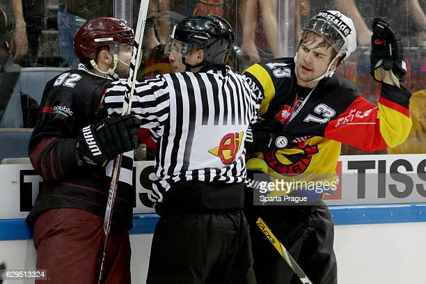 Dominik Uher of HC Sparta Prague challenges Luca Hischier of Bern during the Champions Hockey League Quarter Final match between Sparta Prague and SC...