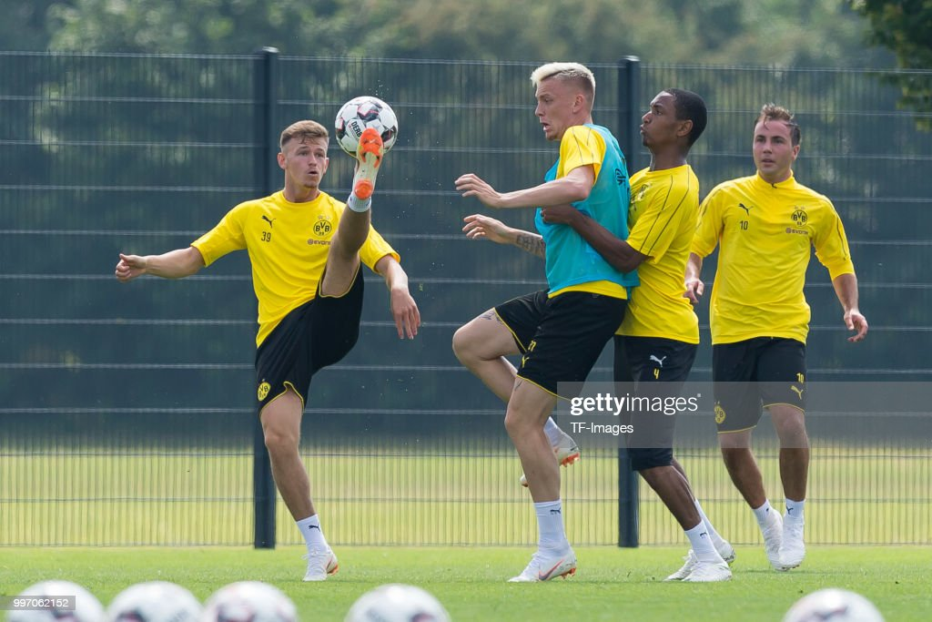 Dominik Wanner of Dortmund U-23, Marius Wolf of Dortmund and Abdou Diallo of Dortmund battle for the ball during a training session at BVB training center on July 12, 2018 in Dortmund, Germany.