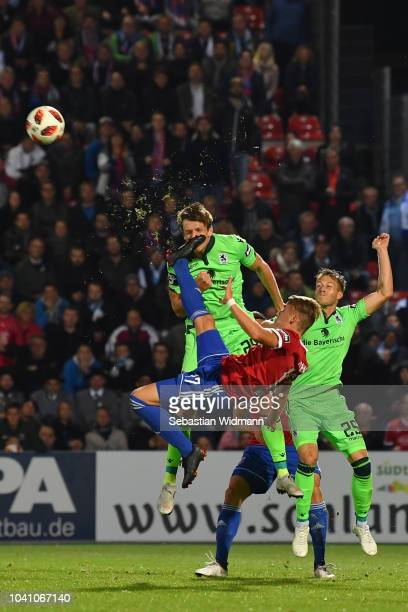 Dominik Widemann of Unterhaching and Herbert Paul of 1860 Muenchen compete for the ball during the 3 Liga match between SpVgg Unterhaching and TSV...