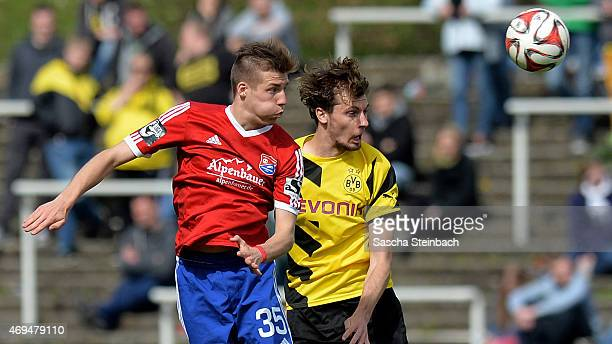 Dominik Widemann of Unterhaching and Jon Gorenc-Stankovic of Dortmund jump for a header during the 3. Liga match between Borussia Dortmund II and...