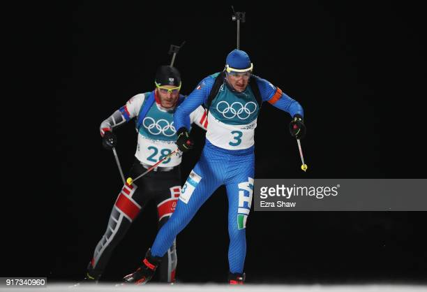 Dominik Windisch of Italy and Simon Eder of Austria compete during the Men's Biathlon 125km Pursuit on day three of the PyeongChang 2018 Winter...