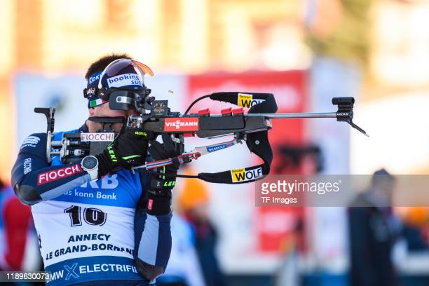 Dominik Windisch of Italy at the shooting range during the Men 10 km Sprint Competition at the BMW IBU World Cup Biathlon Le Grand Bornand at on...