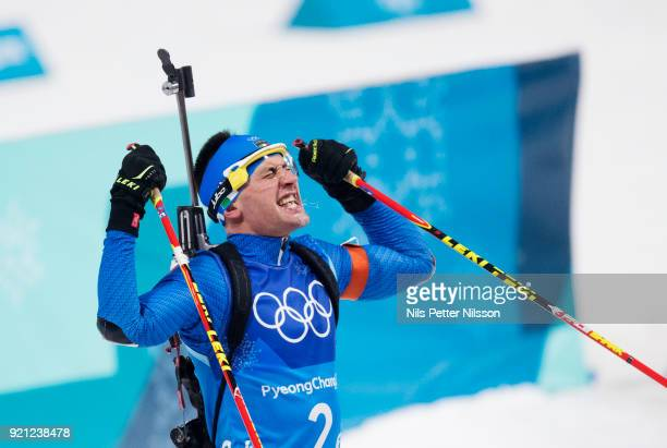 Dominik Windisch of Italy celebrates after finishing third during the Biathlon 2x6km Women 2x75km Men Mixed Relay at Alpensia Biathlon Centre on...