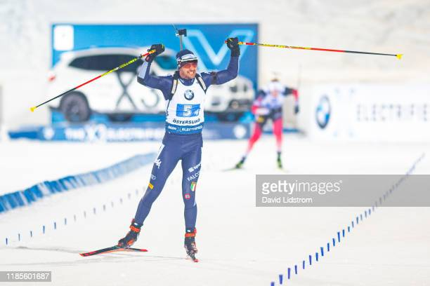 Dominik Windisch of Italy celebrates during the Mixed Relay at the BMW IBU World Cup Biathlon Oestersund at Swedish National Biathlon Arena on...