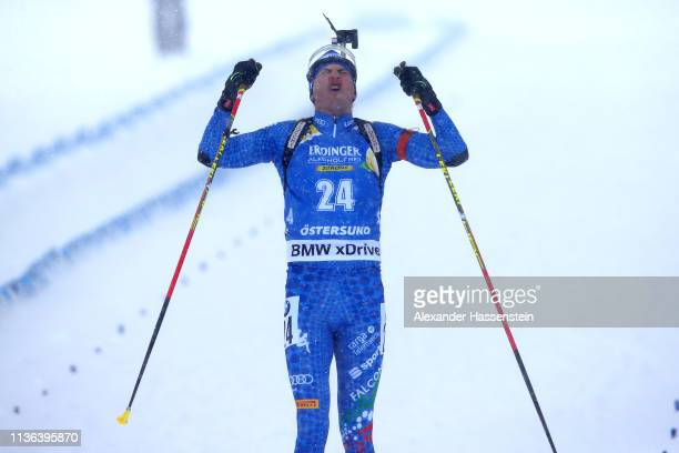 Dominik Windisch of Italy celebrates victory in the Men's Mass Start at the IBU Biathlon World Championships on March 17 2019 in Ostersund Sweden