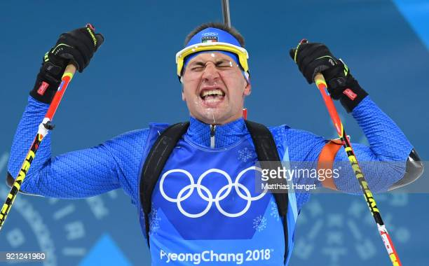 Dominik Windisch of Italy celebrates winning the bronze medal during the Biathlon 2x6km Women 2x75km Men Mixed Relay on day 11 of the PyeongChang...
