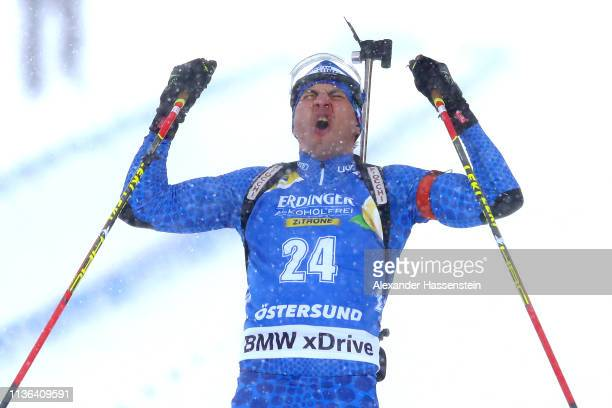 Dominik Windisch of Italy celebrates winning the IBU Biathlon World Championships Men's Mass Start at Swedish National Biathlon Arena on March 17,...