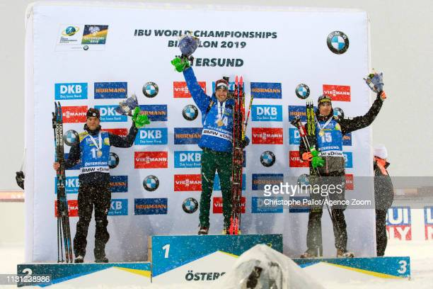 Dominik Windisch of Italy wins the gold medal, Antonin Guigonnat of France wins the silver medal, Julian Eberhard of Austria wins the bronze medal...