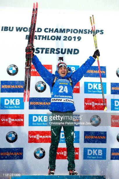 Dominik Windisch of Italy wins the gold medal during the IBU Biathlon World Championships Men's and Women's Mass Start on March 17, 2019 in...