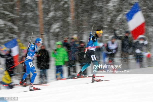 Dominik Windisch of Italy wins the gold medal Martin Fourcade of France in action during the IBU Biathlon World Championships Men's and Women's Mass...
