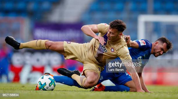 Dominik Wydra of Aue is challanged by Kevin Stoeger of Bochum during the Second Bundesliga match between VfL Bochum 1848 and FC Erzgebirge Aue at...