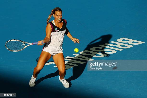 Dominika Cibulkova of Serbia plays a shot during her match against Daniela Hantuchova of Slovak during day one of the 2012 Brisbane International at...