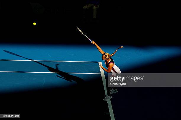Dominika Cibulkova of Serbia serves during her match against Daniela Hantuchova of Slovak during day one of the 2012 Brisbane International at Pat...
