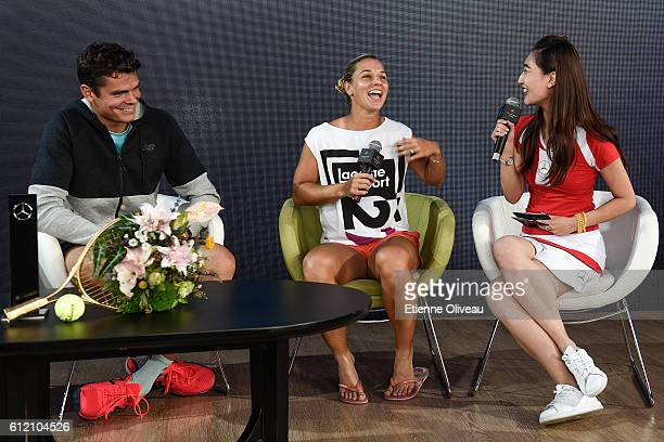 Dominika Cibulkova of Slovakia and Milos Raonic of Canada attend to an event at the Mercedes booth on day three of the 2016 China Open at the China...