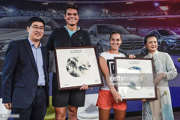 Dominika Cibulkova of Slovakia and Milos Raonic of Canada receive gifts from guests during an event at the Mercedes booth on day three of the 2016...