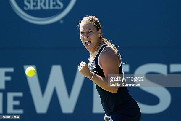 Dominika Cibulkova of Slovakia celebrates a point against Misaki Doi of Japan during day five of the Bank of the West Classic at the Stanford...