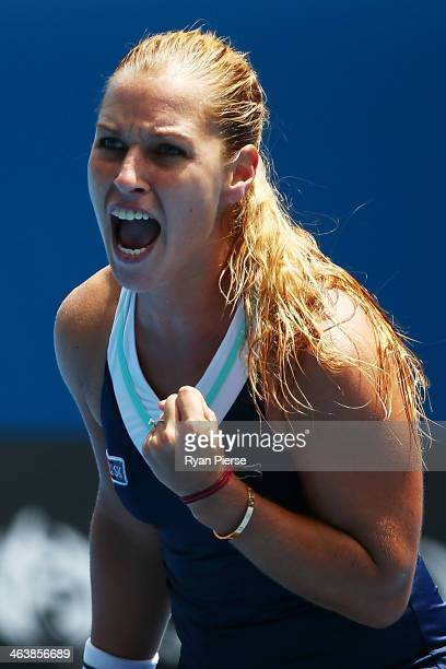 Dominika Cibulkova of Slovakia celebrates a point in her fourth round match against Maria Sharapova of Russia during day eight of the 2014 Australian...
