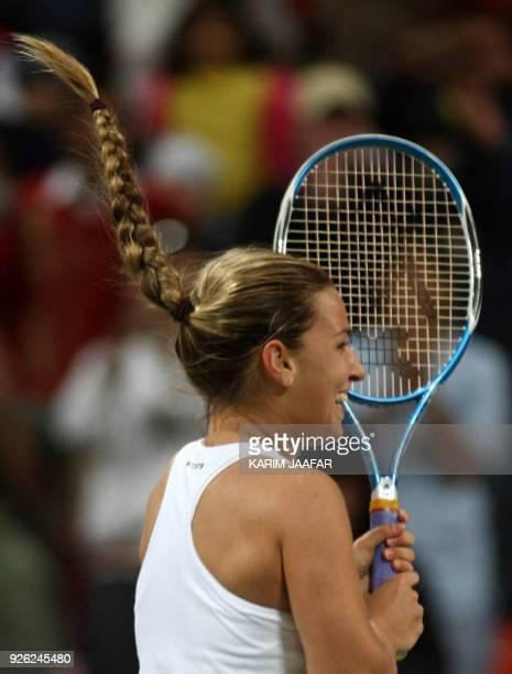 Dominika Cibulkova of Slovakia celebrates after beating US Venus Williams during their tennis match on the fourth day of the 25 million dollar Qatar...