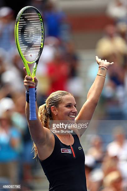 Dominika Cibulkova of Slovakia celebrates after defeating Ana Ivanovic of Serbia to win their Women's Singles First Round match on Day One of the...
