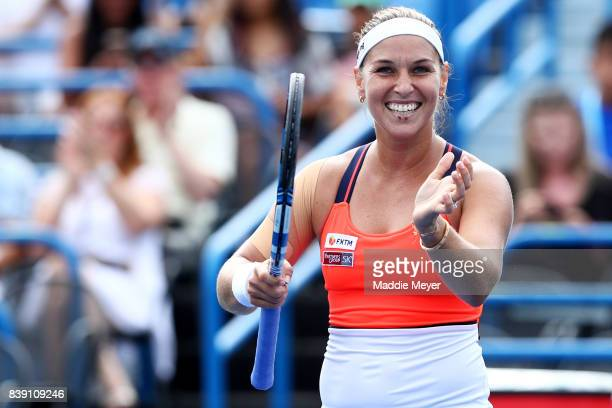 Dominika Cibulkova of Slovakia celebrates after defeating Elise Mertens of Belgium during Day 7 of the Connecticut Open at Connecticut Tennis Center...